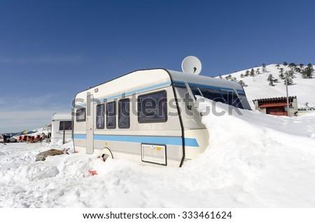 car caravan winter snow - stock photo