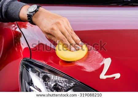 car care, polishing the red car - stock photo