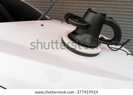 Car care with power buffer machine - stock photo