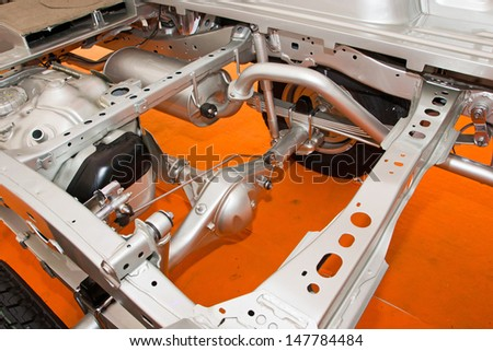 Car chassis with engine. Image of car chassis with engine