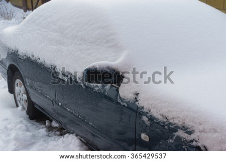 Car covered by ice at winter outdoor parking place