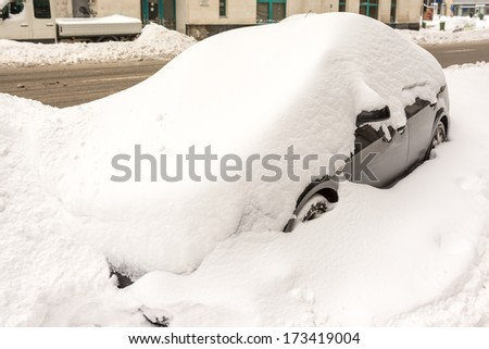 Car Covered In Fresh White Snow - stock photo