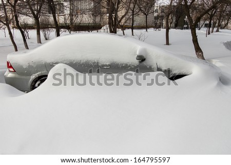 Car covered in snow after a blizzard