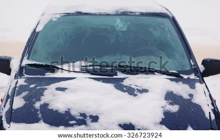 Car covered with snow, frozen vehicle winter, view windshield - stock photo