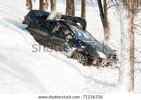 car crash accident at snow road in winter - stock photo