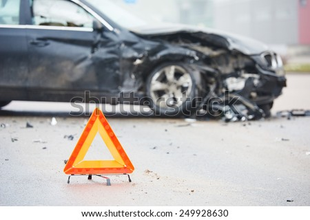 car crash accident on street, damaged automobiles after collision in city - stock photo