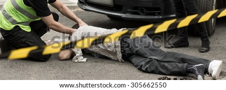 Car crash area surrounded by warning tape - stock photo