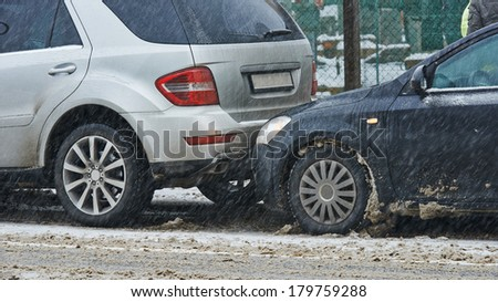 car crash collision accident on an city road in winter - stock photo
