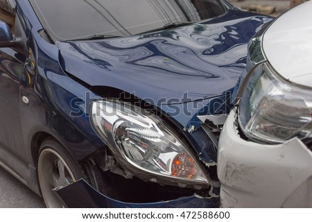 car crash from car accident on the road in a city between saloon versus pickup wait