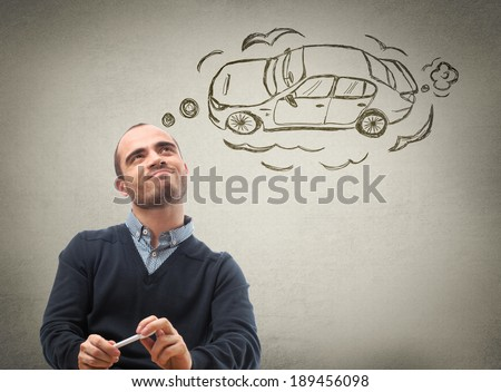 Car credit concept. Man dreaming about car - stock photo