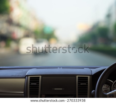 car dash panel with  blurred street view template for your design - stock photo