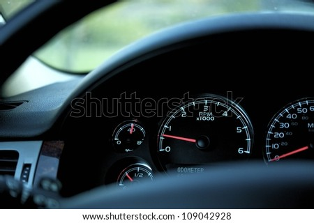 Car Dash RPM (Rotation Per Minute), Oil Temperature, Fuel and Speedometer Closeup Photo. Modern Vehicle Dash. Transportation Photo Collection - stock photo