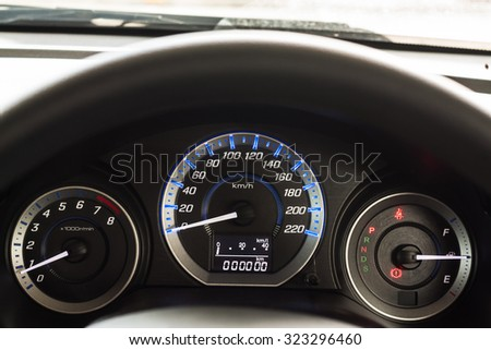 Car Dashboard. Close up image of illuminated car dashboard, lose up of car dashboard and Odometer