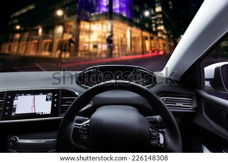 Car dashboard / interior with right hand drive / side steering wheel - stock photo