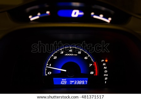 Car Dashboard with Illuminated Tachometer and Speedometer, HDR