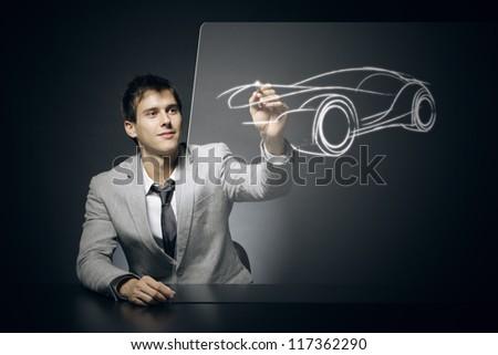 Car designer draws his dream car - stock photo
