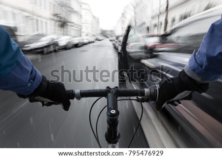 Car-dooring -- Cyclist in the rain on collision course with car door & Cardooring Cyclist Rain On Collision Course Stock Photo 795476929 ...