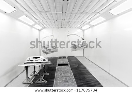 Car doors hanging inside a car paint box - stock photo