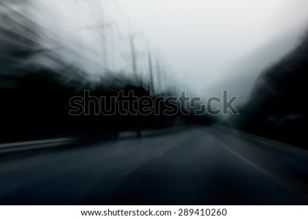Car driver on the road in speed motion blur. Speed motor, haunting or car accident concept. - stock photo
