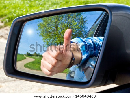 Car driver with thumb up - stock photo