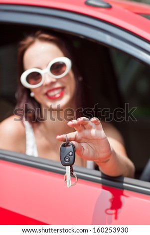 car driver woman smiling showing new car keys and car. - stock photo