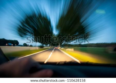 car driving drunk at night - stock photo