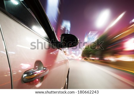 Car driving fast down in the city