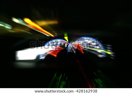 Car driving fast motion blur with slow speed shutter. - stock photo