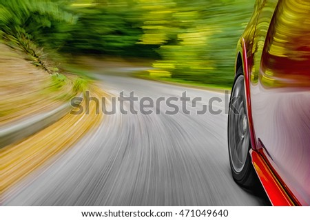 Car driving fast on a mountain road