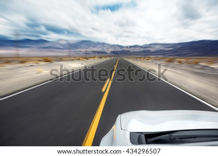 Car driving on an interstate or highway. Motion blur from speed
