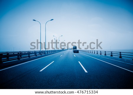 car driving on bridge,shanghai,chona.