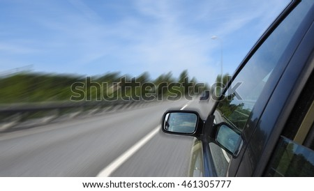 Car driving on freeway on lonely road, motion blur