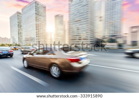 Car driving on road in Beijing, motion blur - stock photo