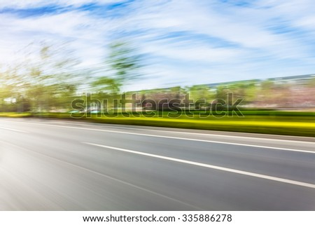 Car driving on road in city background, motion blur