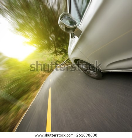 Car driving on the highway sky - stock photo