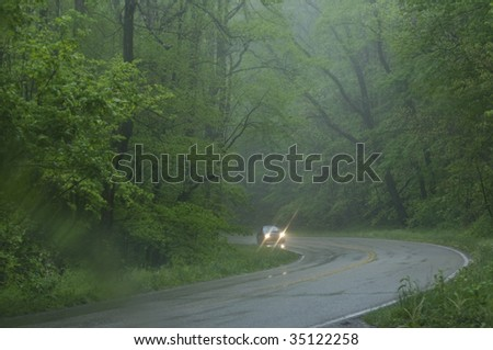 car driving on wet road in rain