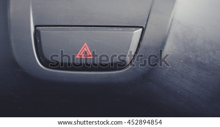 Car emergency button, Car emergency attention light button in red triangle.  - stock photo