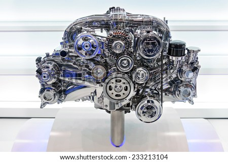 Car engine. Concept of modern automobile motor on light background - stock photo
