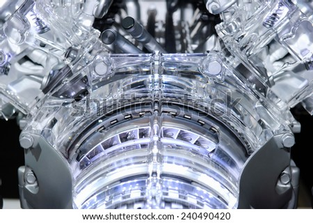 Car engine. Concept of modern automobile motor with metal, chrome, plastic and glass parts with lights. - stock photo