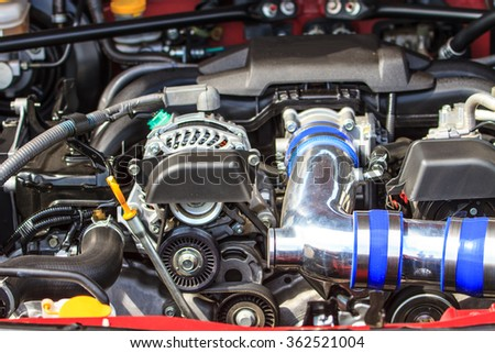Car engine, Fragment of modern automobile motor - stock photo