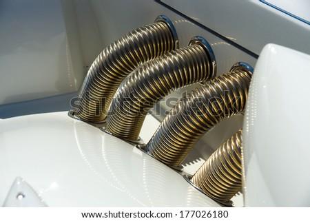 Car exhaust manifold. - stock photo