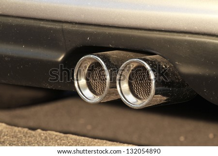Car exhaust pipe - stock photo