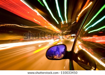 car fast drive at night - stock photo