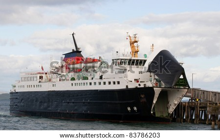Car ferry approaching port - stock photo