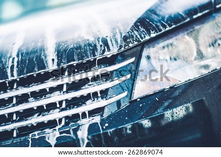Car Foaming Closeup. Car Active Foam Cleaning Theme. - stock photo