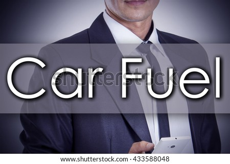 Car Fuel - Young businessman with text - business concept - horizontal image - stock photo