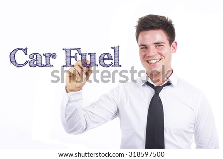 Car Fuel - Young smiling businessman writing on transparent surface - stock photo