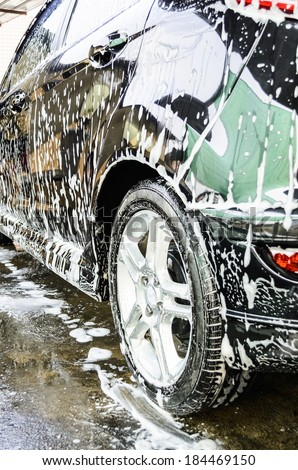 car getting a wash with soap, car washing - stock photo