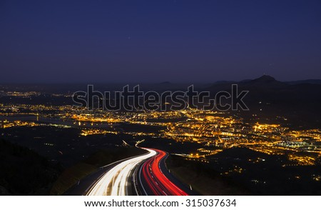 car go to the city at night - stock photo