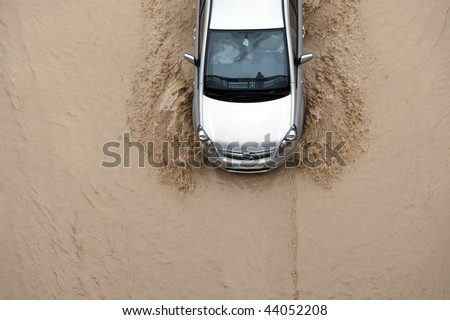 Car going through flood highway - stock photo